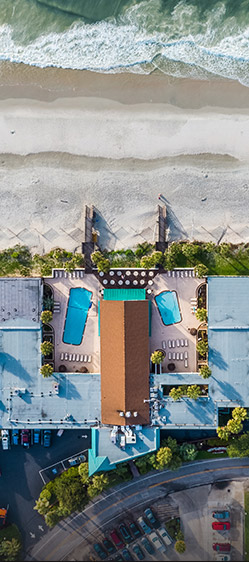 Aerial shot of hotel with two pools by the beach