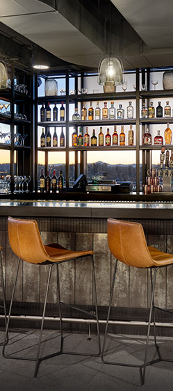 Bar with wooden stools and mountain view