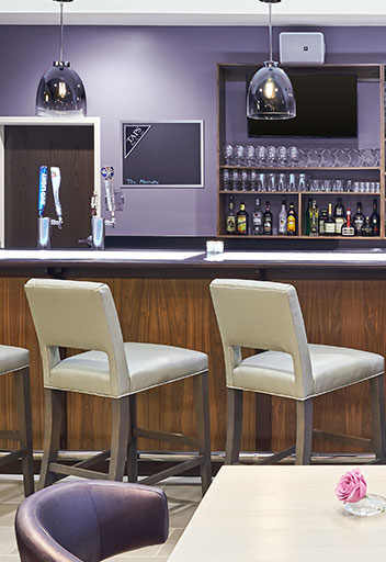 Two stools by bar