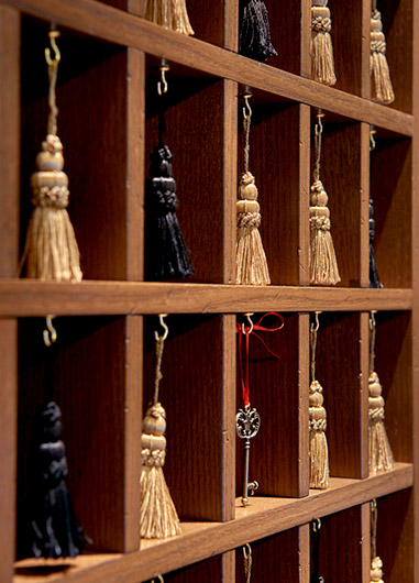 Cubby furniture with tassels