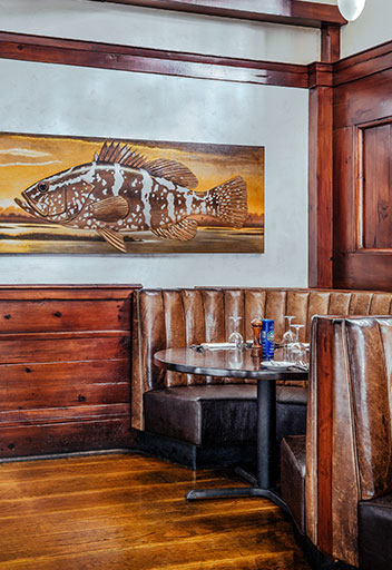 Booth in restaurant with fish painting
