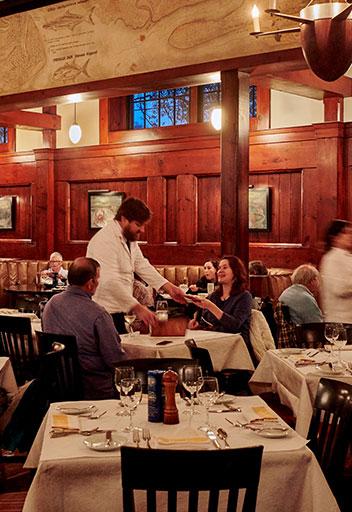 Waiter serving couple