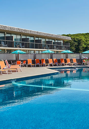 Pool with orange loungers