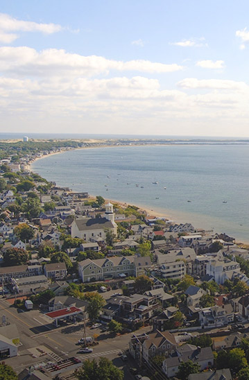 Aerial shot of town surrounding body of water