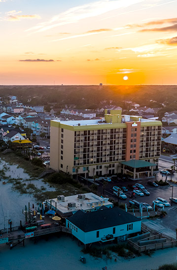 Aerial shot of hotel by the water
