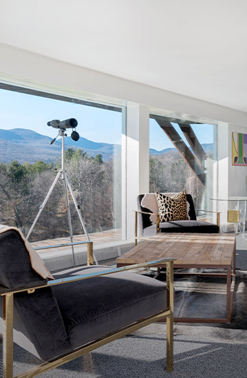 hotel room with living space overlooking mountains