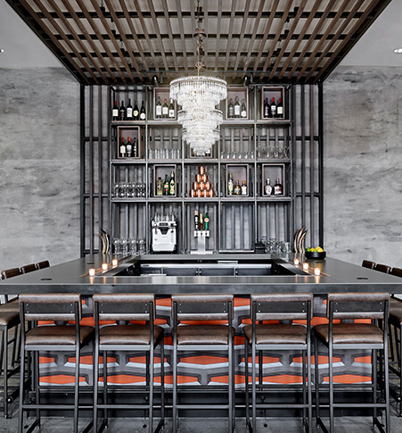 Elegant all black bar with chandelier