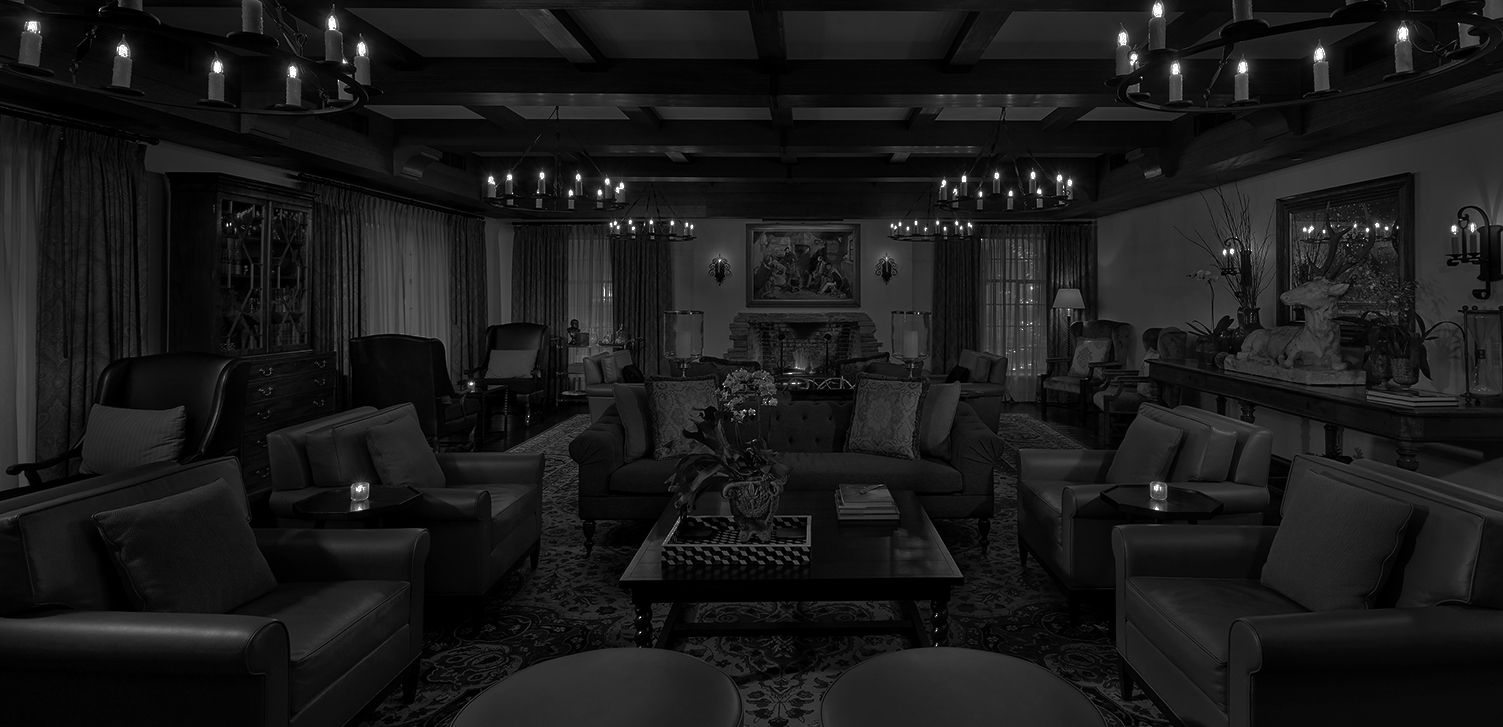 black and white image of a lobby with various seating