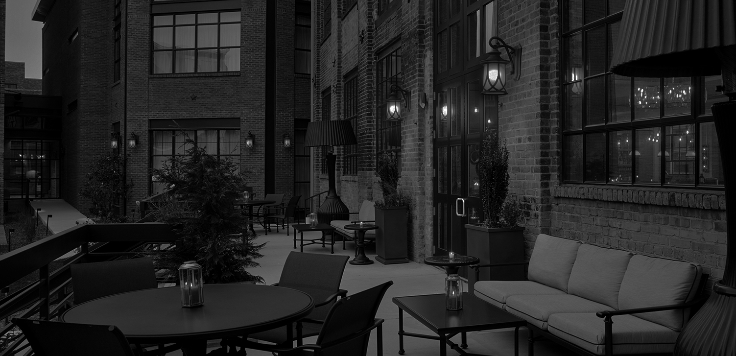 Outdoor seating next to brick wall