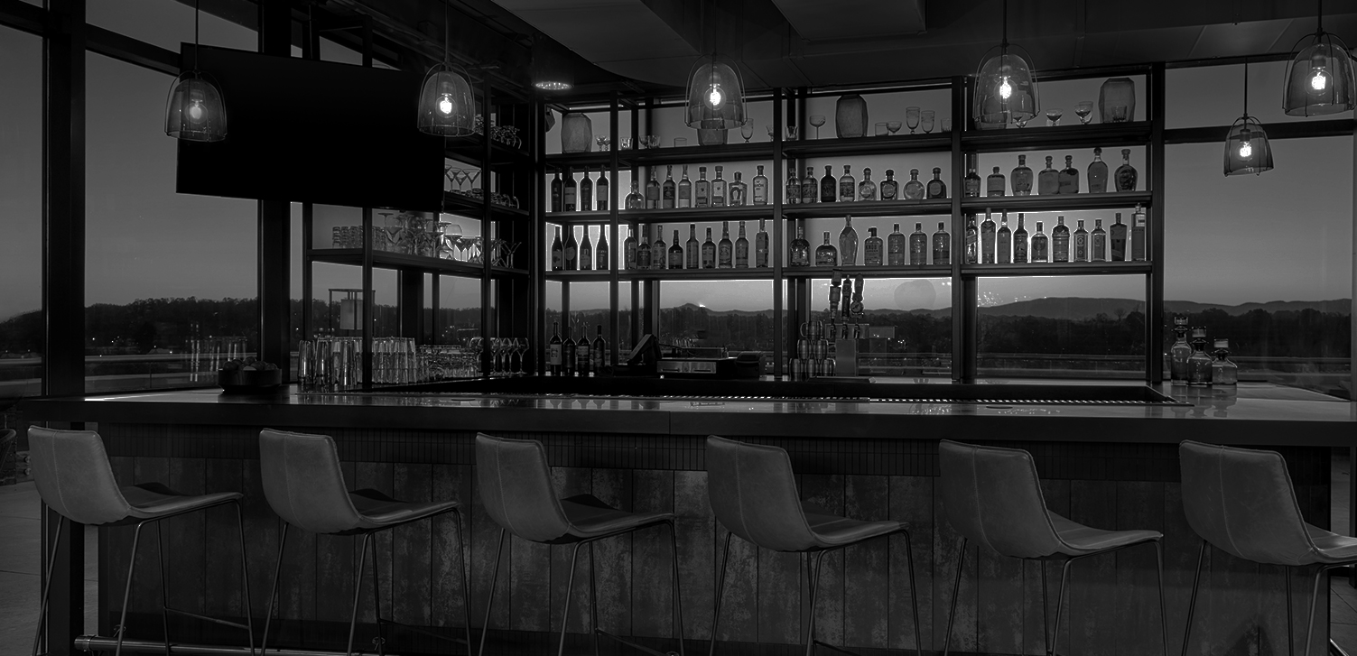 black and white image of a bar area