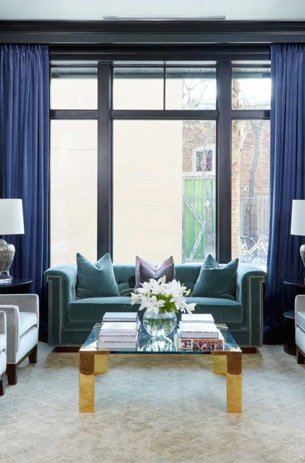 coffee table in front of window with blue curtains