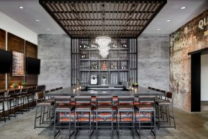 a large grey bar with leather barstools