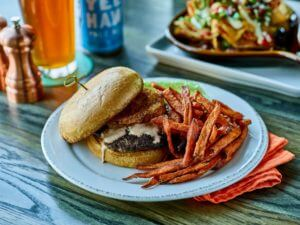 a burger with sweet potato fries