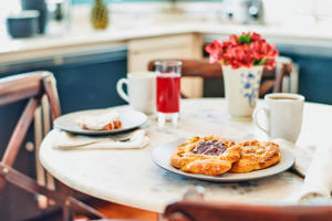 a table with coffee and pastries