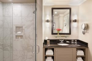a modern bathroom with a marble vanity