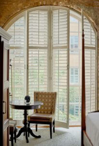 a large window with plantation shutters