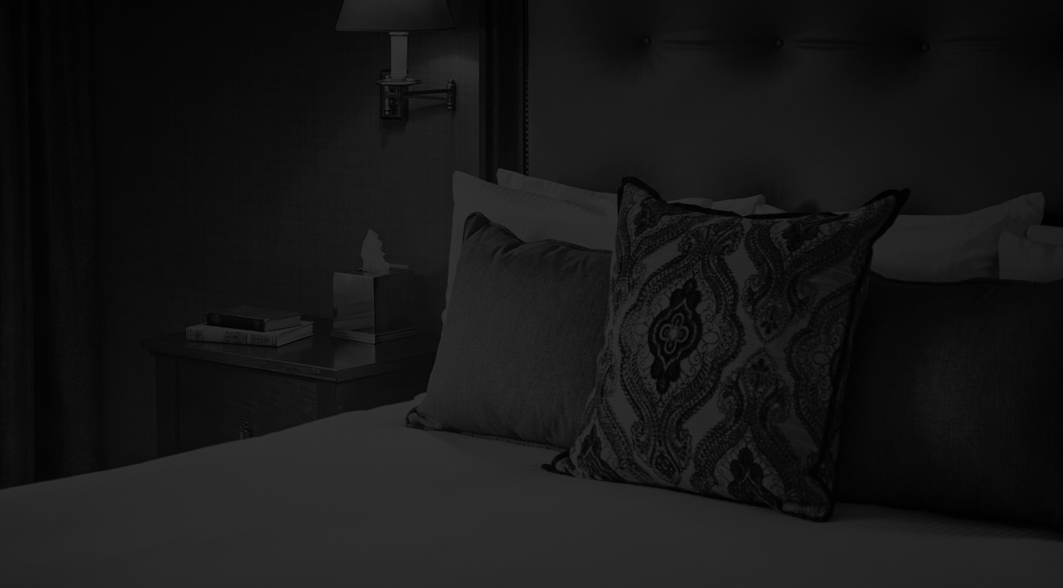 black and white image of a guest bed